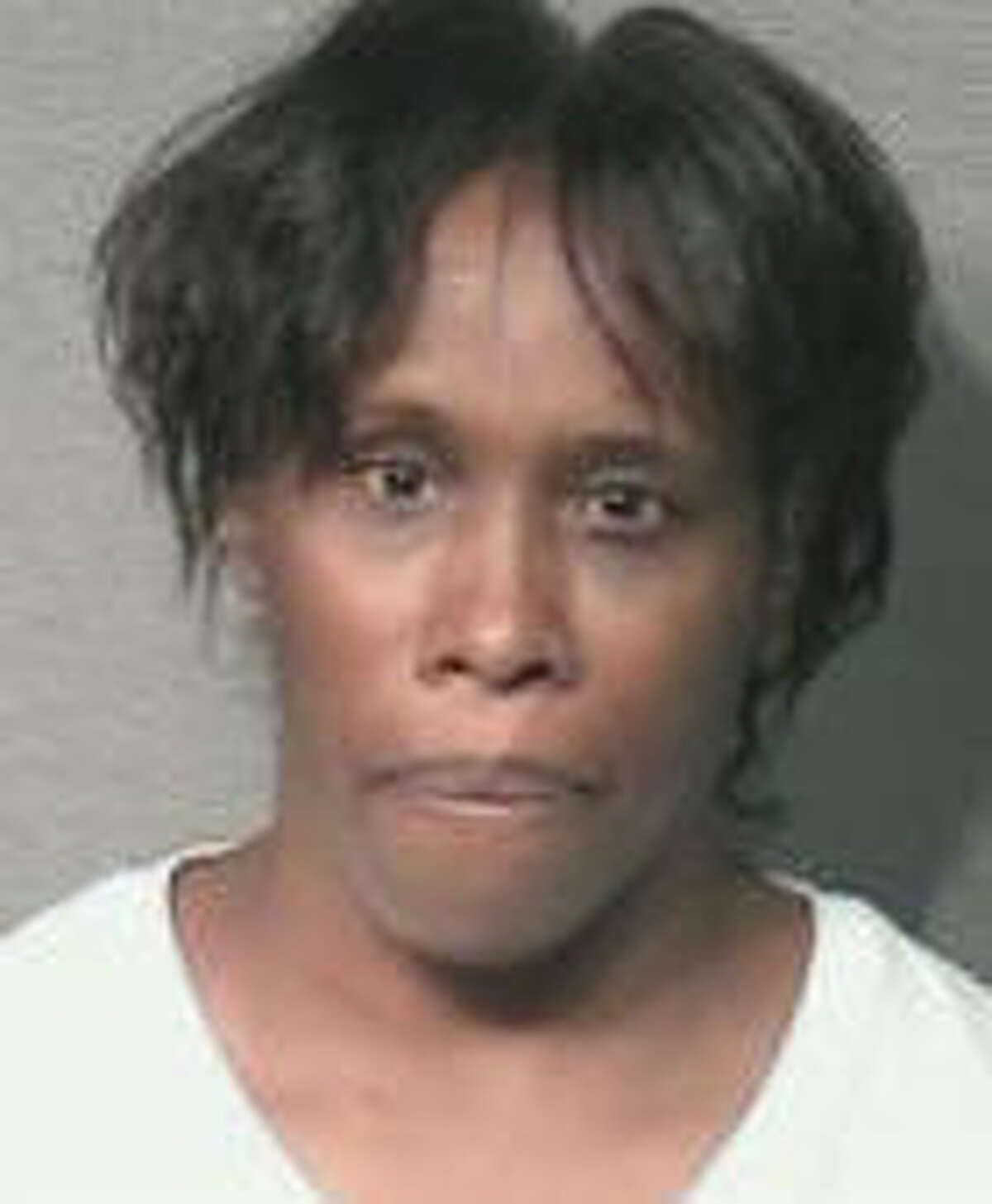 Pebbles Hines is accused of running over her neighbor as he mowed the lawn.