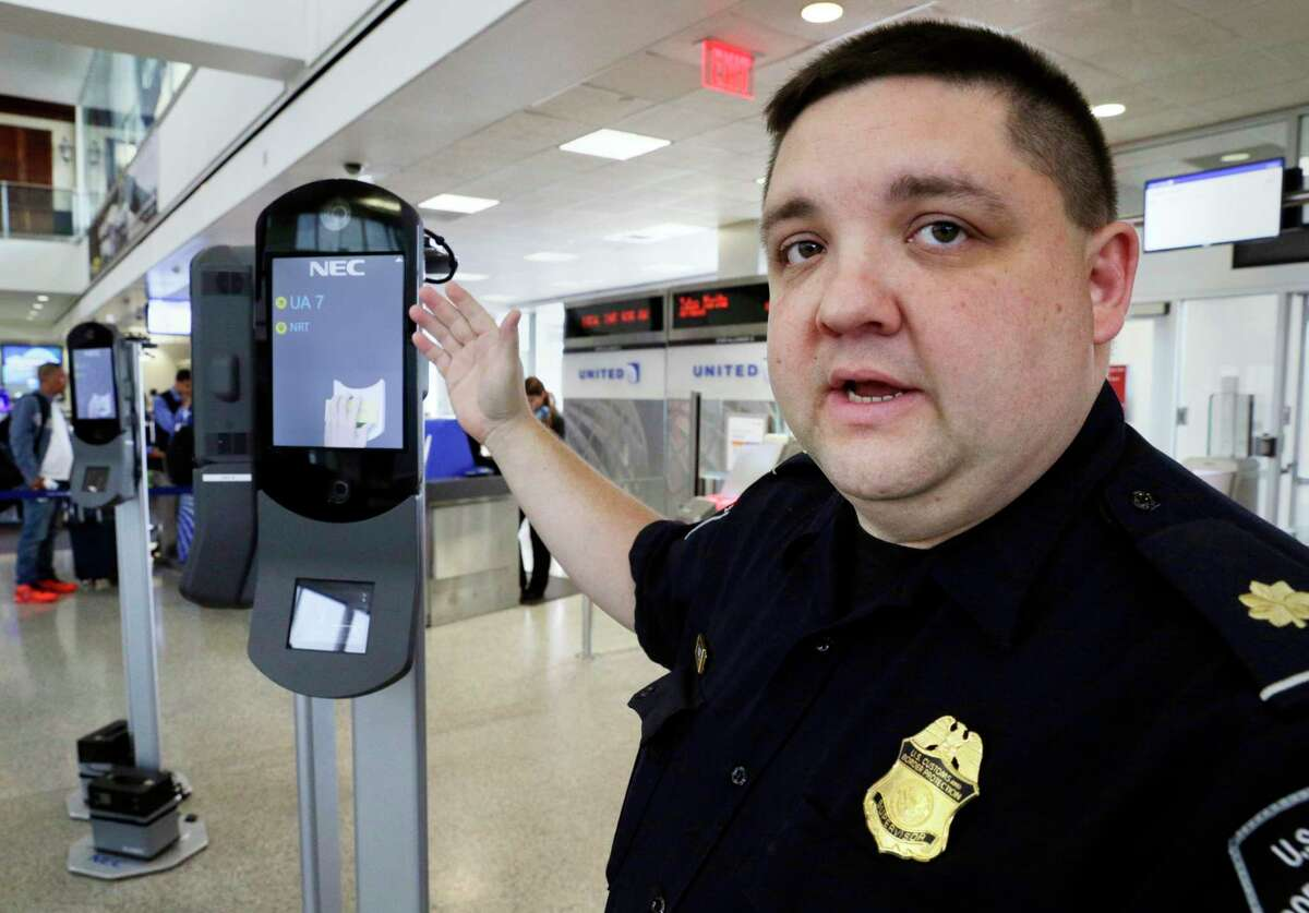 Ian Ramirez, a supervisor with U.S. Customs and Border Protection, explains the workings of the new face recognition kiosks at United Airlines gate E7 for a flight to Tokyo at Bush Intercontinental Airport in Houston, TX, June 29, 2017. (Michael Wyke / For the Chronicle)