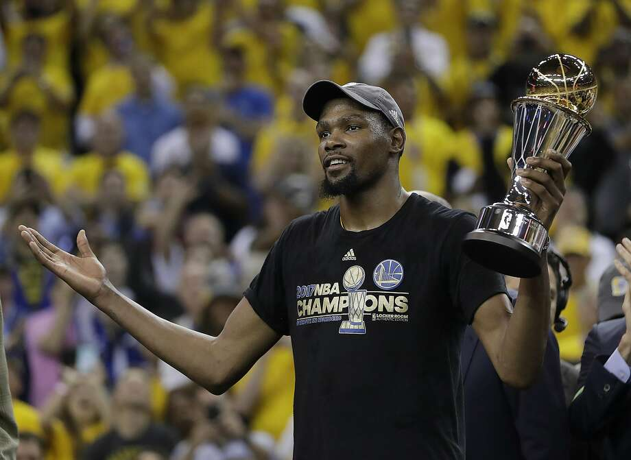 Forward Kevin Durant is willing to take less than initially expected to re-sign with the Warriors, according to a Bay Area News Group report. Durant, who has made more than $135 million in his career not including endorsement deals, effectively gave up part of his potential earnings so the Warriors could keep their core together. Photo: Marcio Jose Sanchez, Associated Press