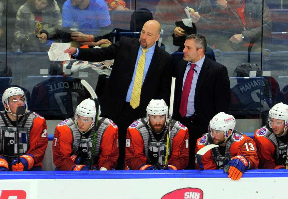 Sound Tigers Assistant Coach Eric Boguniecki, right, confers with Head Coach Brent Thompson during hockey action against Binghamton at the Webster Bank Arena in Bridgeport, Conn. on Saturday Dec. 3, 2016. Photo: Christian Abraham / Hearst Connecticut Media / Connecticut Post