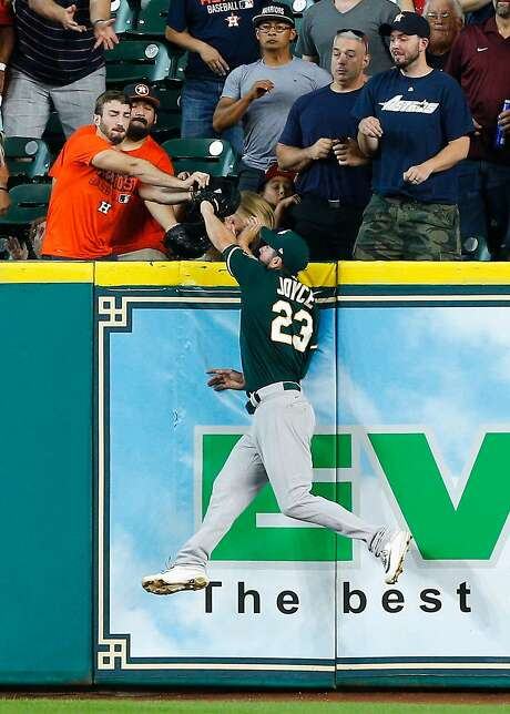HOUSTON, TX - JUNE 29:  Matt Joyce #23 of the Oakland Athletics makes a leaping catch at the wall on fly ball by Josh Reddick #22 of the Houston Astros in the first inning at Minute Maid Park on June 29, 2017 in Houston, Texas.  (Photo by Bob Levey/Getty Images) Photo: Bob Levey, Getty Images