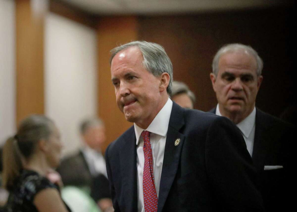 Texas Attorney General Ken Paxton leaves the 177th District Court, after at the Harris County Criminal Justice Center, Thursday, June 29, 2017, in Houston. Paxton is facing two counts of felony securities fraud, and a lesser felony charge of failing to register as an insurance adviser with the state.