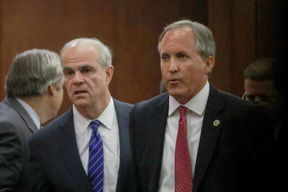 Texas Attorney General Ken Paxton, right, and his attorney Philip Hilder, left, leave the 177th District Court, after at the Harris County Criminal Justice Center, Thursday, June 29, 2017, in Houston. Paxton is facing two counts of felony securities fraud, and a lesser felony charge of failing to register as an insurance adviser with the state.