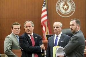 Texas Attorney General Ken Paxton, second from left, waits with members of his legal team, Cordt Akers, left, Philip Hilder, second from right, and Mitch Little, right, in the 177th District Court, at the Harris County Criminal Justice Center, Thursday, June 29, 2017, in Houston. Paxton is facing two counts of felony securities fraud, and a lesser felony charge of failing to register as an insurance adviser with the state.