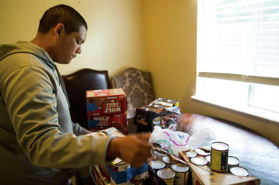 Sergio Landa, 18, a homeless high school graduate and a part of the Turning Point program at the Roy Maas Youth Alternatives center, does morning chores in the temporary housing provided by the program in San Antonio, Texas on June 29, 2017. Photo: Carolyn Van Houten, Staff / San Antonio Express-News / 2017 San Antonio Express-News