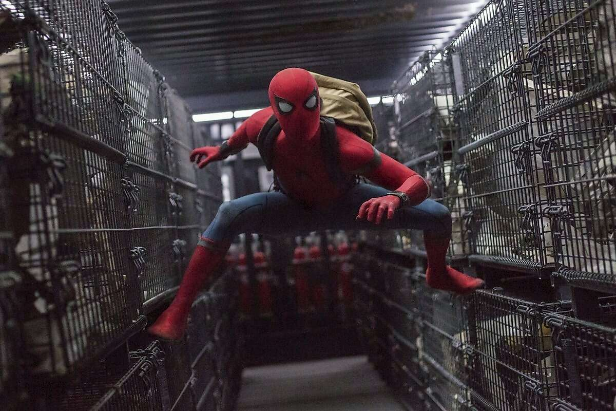 Peter Parker, played by Tom Holland, below, must navigate both high school and the superhero universe as the powers of his alter-ego, Spider-Man, emerge.