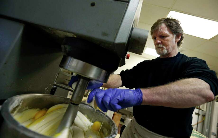 FILE - In this March 10, 2014 file photo, Masterpiece Cakeshop owner Jack Phillips cracks eggs into a cake batter mixer inside his store in Lakewood, Colo. Photo: Brennan Linsley, STF / Internal