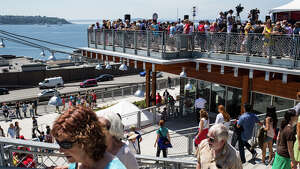 Hundreds fill Pike Place's new Marketfront for its grand opening on Thursday, June 29, 2017. The new space features more spots for vendors, senior housing, restaurants and views of Elliott Bay.