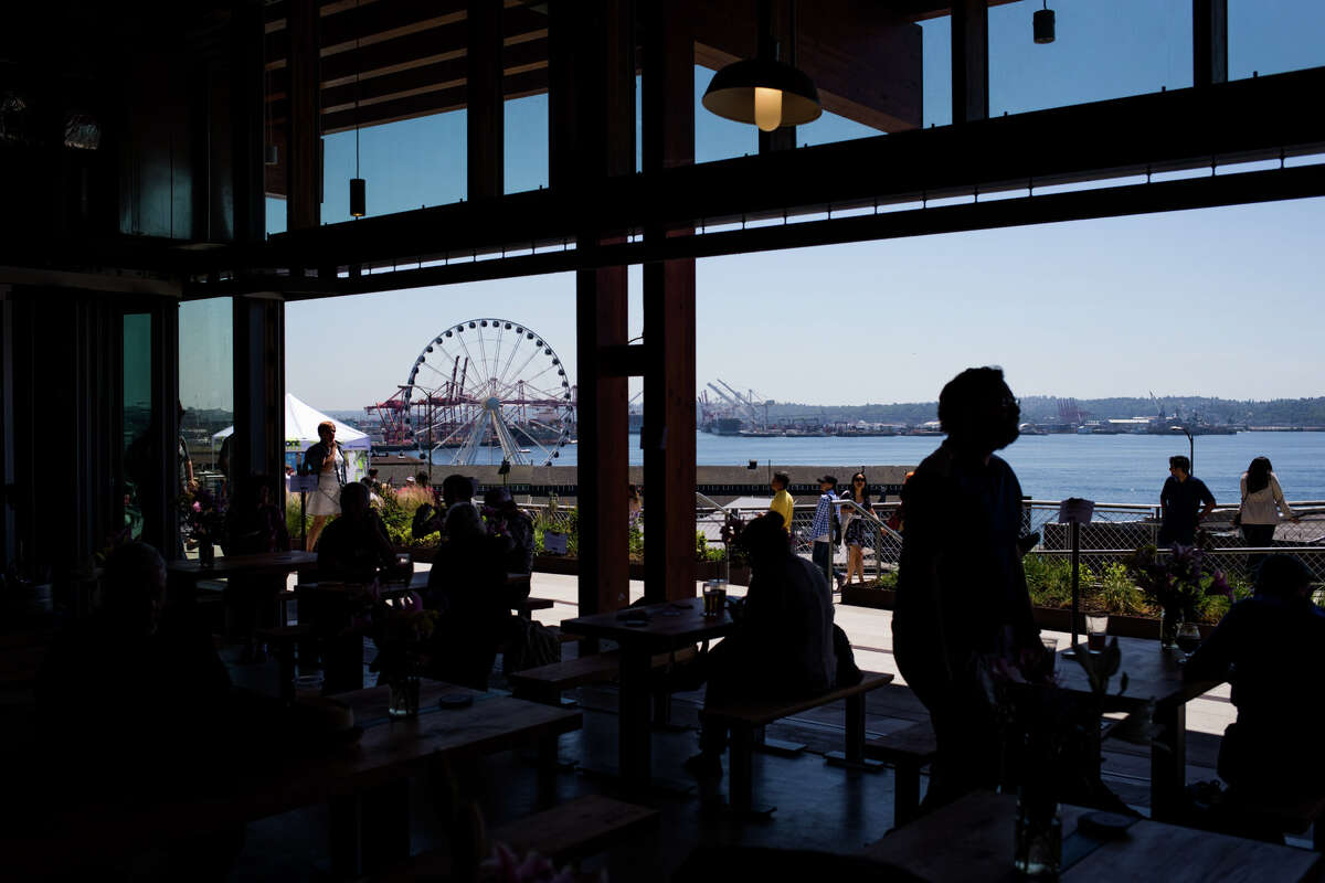 The Seattle Great Wheel is seen from the Producers Hall in Pike Place Marketfront during its grand opening on Thursday, June 29, 2017.