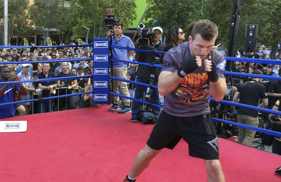 Australian boxer Jeff Horn trains in front of the public in a mall in Brisbane, Australia, on Thursday ahead of Sunday's (saturday night PT) title bout against Manny Pacquiao. Photo: John Pye, Associated Press