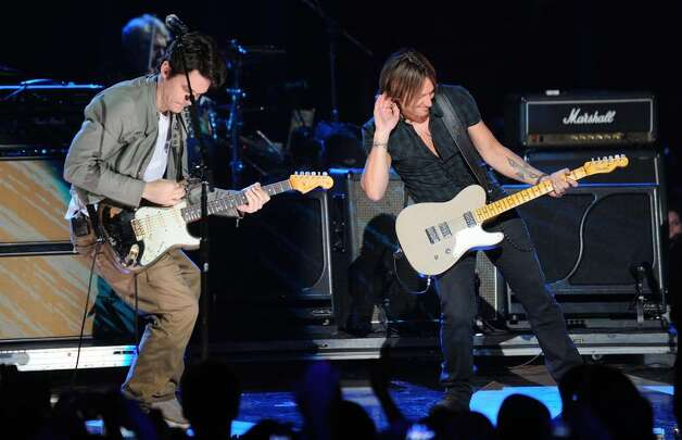 NASHVILLE, TN - JUNE 09:  Musicians John Mayer and Keith Urban perform onstage at the 2010 CMT Music Awards at the Bridgestone Arena on June 9, 2010 in Nashville, Tennessee.  (Photo by Jason Merritt/Getty Images) *** Local Caption *** John Mayer;Keith Urban Photo: Jason Merritt, Getty Images / 2010 Getty Images