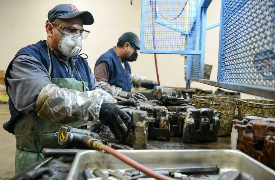 This 2014 file photo shows workers in a Nuevo Laredo, Mexico, brake manufacturing plant. A Federal Reserve Bank of Dallas study says integration of U.S.-Mexico manufacturing under the North American Free Trade Agreement could be key to U.S. global competitiveness. Photo: Courtesy Photo From The Government Of Nuevo Laredo / Gobierno de Nuevo Laredo