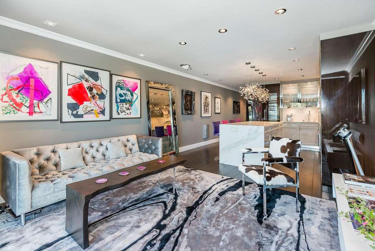 The great room features an open floor plan with hardwood flooring.