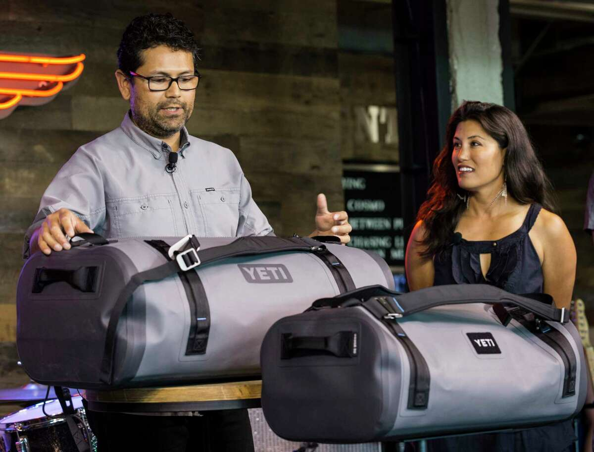 Alex Baires, category manager for YETI soft sided products, unveils a Panga duffel during a product unveiling party at the YETI signature store on Thursday, June 29, 2017, in Austin.