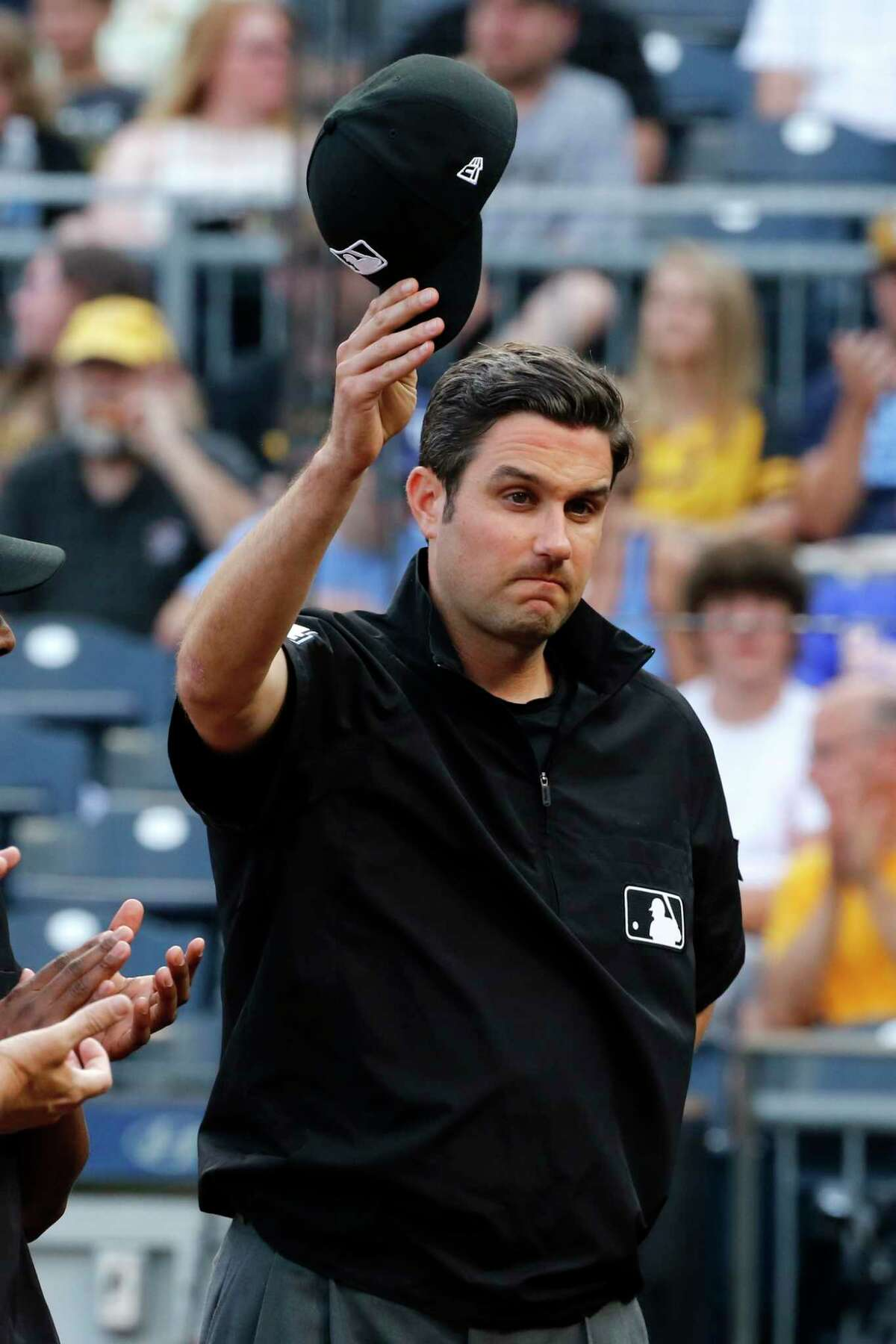 Major league umpire John Tumpane was recognized for his heroism Wednesday before the game between the Pittsburgh Pirates and Tampa Bay Rays in Pittsburgh on Thursday.