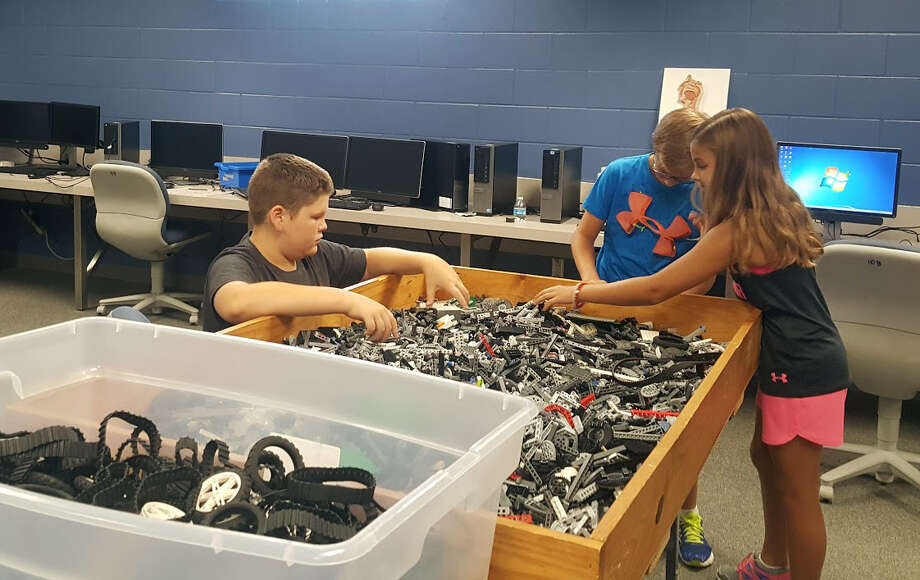 Tyler Matthews, Logan Beach and Lauren Beach collaborate to build robots and drones during an Humble ISD CATE Center summer camp on Wednesday, June 28. Photo: Melanie Feuk
