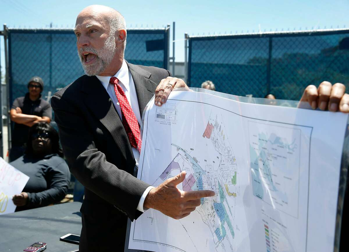 Attorney David Anton identifies the locations where contaminated soil was detected at the former Hunters Point Naval Shipyard during a news conference in San Francisco, Calif. on Thursday, June 29, 2017. Former employees of Tetra Tech, the firm hired to cleanup contaminated radioactive soil, allege that Tetra Tech took fake soil samples and falsified test results.