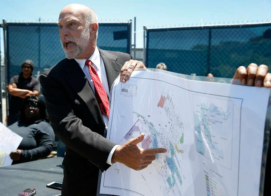 Attorney David Anton identifies the locations where contaminated soil was detected at the former Hunters Point Naval Shipyard during a news conference in San Francisco, Calif. on Thursday, June 29, 2017. Former employees of Tetra Tech, the firm hired to cleanup contaminated radioactive soil, allege that Tetra Tech took fake soil samples and falsified test results. Photo: Paul Chinn / The Chronicle 2017