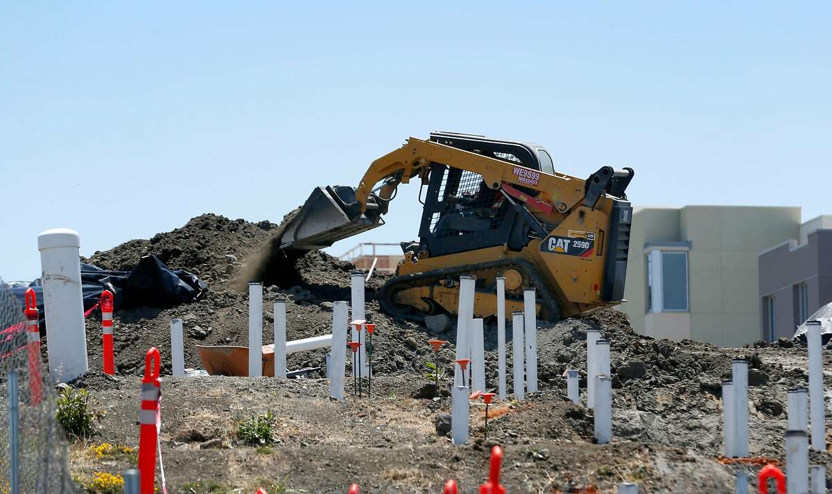 Construction workers building new homes remove soil at the former Hunters Point Naval Shipyard in San Francisco, Calif. on Thursday, June 29, 2017. Former employees of Tetra Tech, the firm hired to cleanup contaminated radioactive soil, allege that Tetra Tech took fake soil samples and falsified test results.