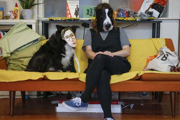 Artist Lindsey White, who is one of ther year's SECA Art Award winners, and her dog, Lolly, are seen in her studio on Wednesday, June 21, 2017 in San Francisco, Calif.