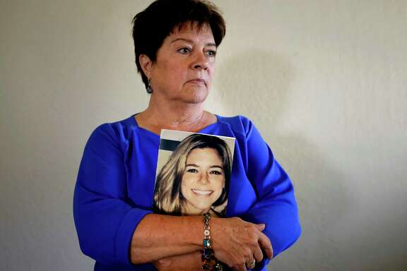Liz Sullivan, Kate Steinle's mother, holds at her home in Livermore, Calif., a photo of her daughter, who was shot and killed on Pier 14 in July 2015 in San Francisco, Calif.