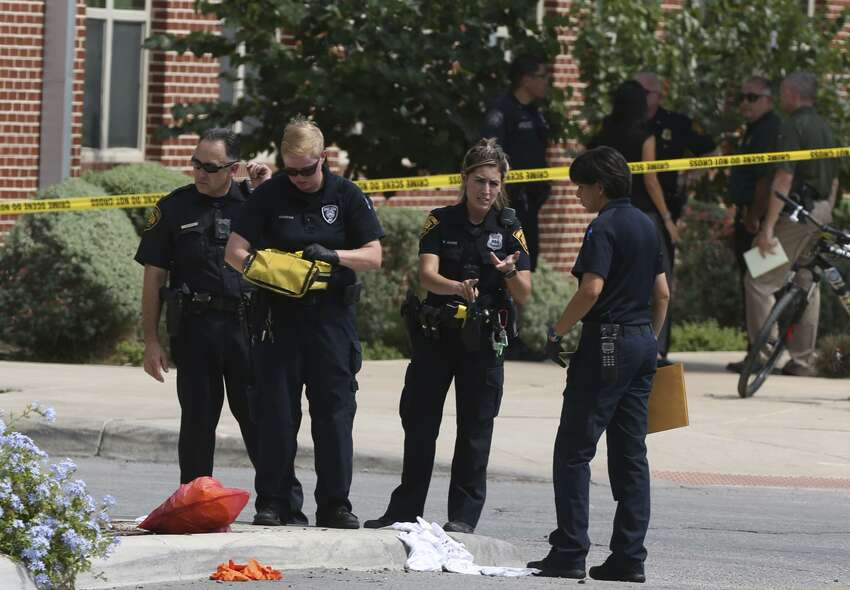 Police officers secure the scene Thursday, June 29, 2017 of an officer-involved shooting near Main and Evergreen Street just east of San Antonio College.