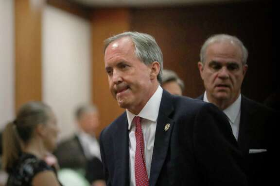 Texas Attorney General Ken Paxton leaves the 177th District Court at the Harris County Criminal Justice Center.