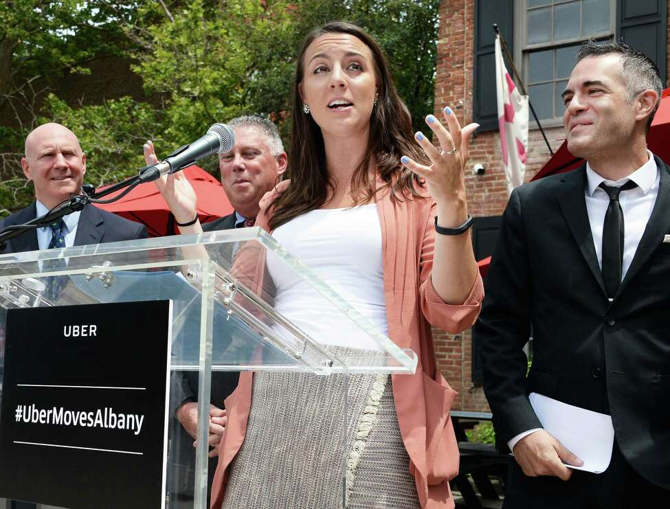 Uber spokesperson Carlie Waibel, center, joins state and local leaders and the Capital Region Ridesharing Coalition to laud the launch of ride-hailing services in upstate New York during a news conference Thursday June 29, 2017 in Albany, NY. (John Carl D'Annibale / Times Union)