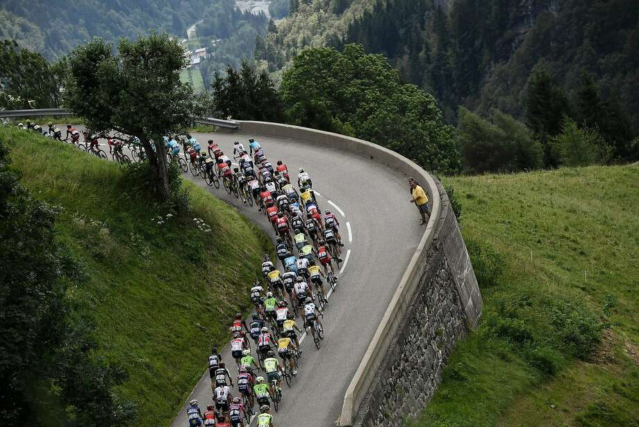 The pack rides between Megeve and Morzine-Avoriazin in the French Alps during the 20th stage of the 2016 Tour de France, which was won by British rider Chris Froome. Photo: JEFF PACHOUD, AFP/Getty Images