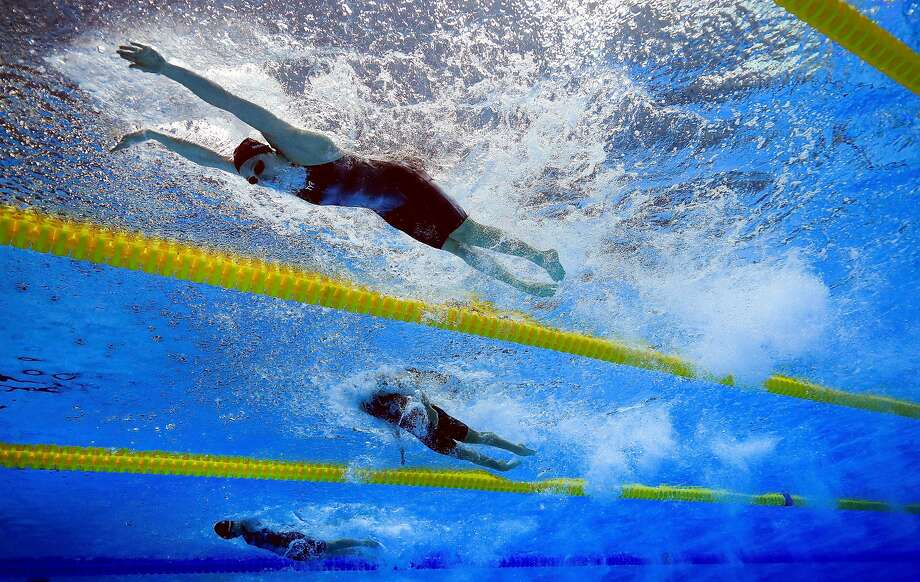Lily King leads the pack and the world with her time of 29.66 seconds in the 50-meter breaststroke, .22 seconds ahead of her Russian rival. Photo: Tom Pennington, Getty Images
