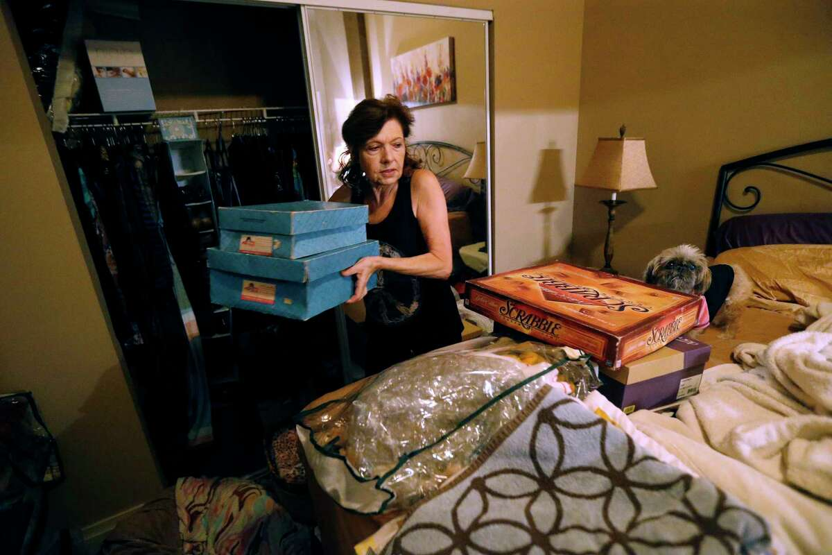 Carolyn Horton packs in preparation for her move as her affordable housing subsidies expire.