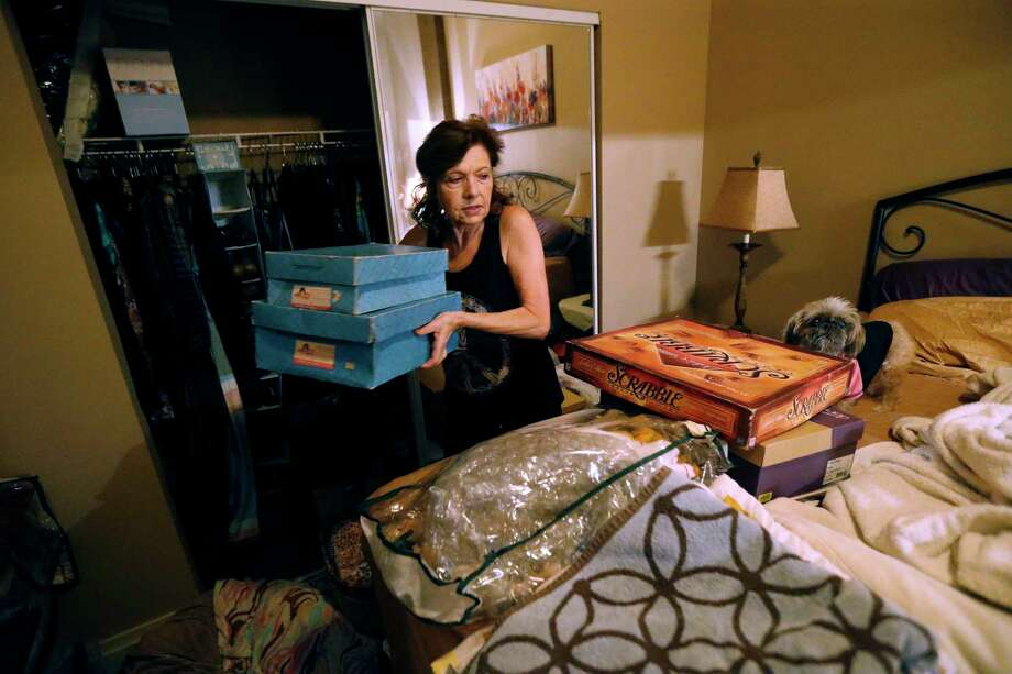 Carolyn Horton packs in preparation for her move as her affordable housing subsidies expire. Photo: Gerald Herbert, STF / Copyright 2017 The Associated Press. All rights reserved.