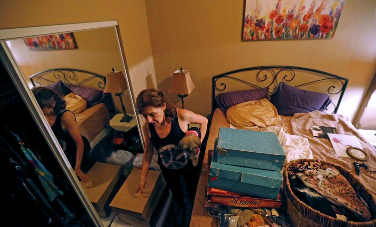 """In this June 26, 2017 photo, Carolyn Horton packs her belongings in her apartment that she has to move out of as her affordable housing subsidies expire, at the American Can Apartments in New Orleans. Says Horton, """"My rent was $810, but they want to raise it to $1,100 or $1,200. Now I have to income-qualify for a new place and with just under $700 in Social Security, that's not easy."""" (AP Photo/Gerald Herbert)"""