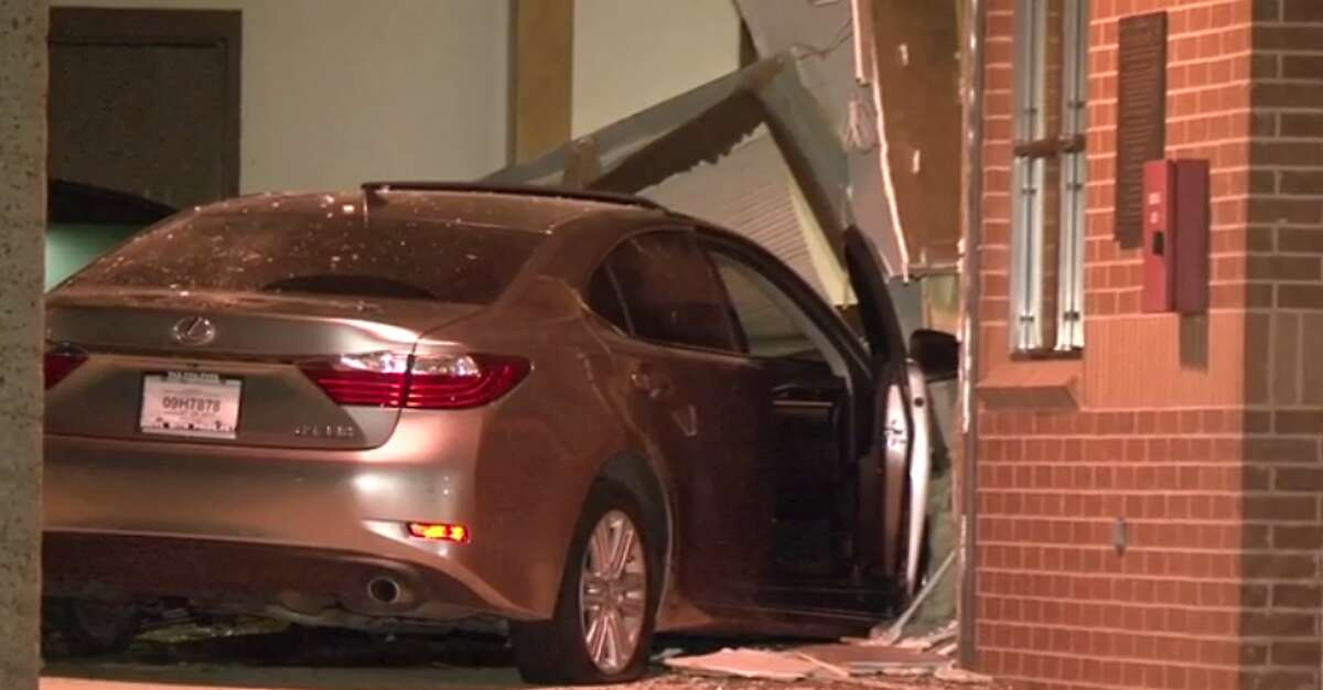 A car crashed through a fire station late Thursday near the Greatwood master planned community in Fort Bend County, causing damage to the building. (Metro Video)