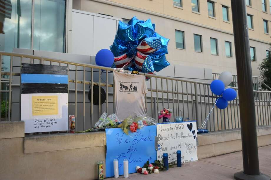A memorial is building outside Public Safety Headquarters in downtown San Antonio after two officers were shot, one fatally, on Thursday, June 29, 2017, during a crime prevention patrol. Officer Miguel Moreno, 32, was pronounced dead at 11:11 a.m. Friday, June 30. One suspect has been killed and another suspect detained. Photo: Caleb Downs / San Antonio Express-News