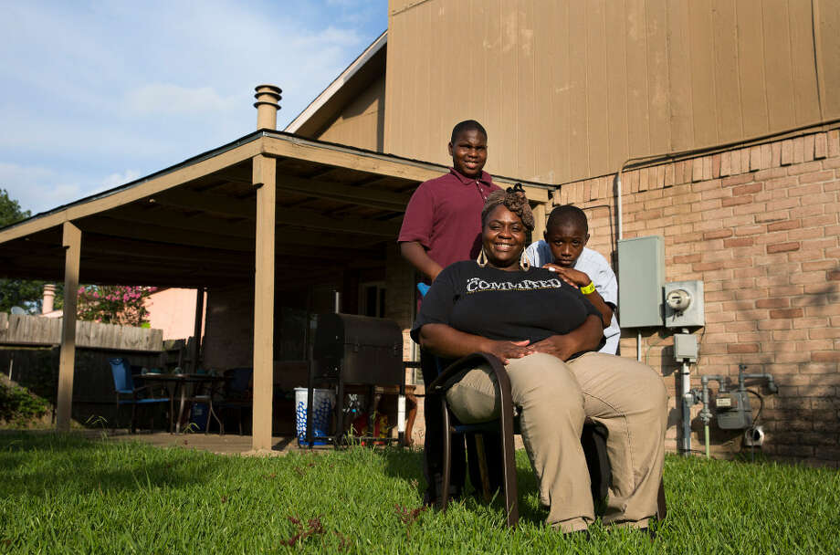 Mary Courtney, 32, poses for a photo with her sons Christian, 12, and Jeremiah, 9, at their house Thursday, June 29, 2017, in Stafford. The family moved to Houston from Shreveport, Louisiana, in 2013 for better education for her kids. Her oldest son, Christian, goes to KIPP Liberation College Preparatory and Jeremiah goes to KIPP PEACE Elementary School Photo: Yi-Chin Lee