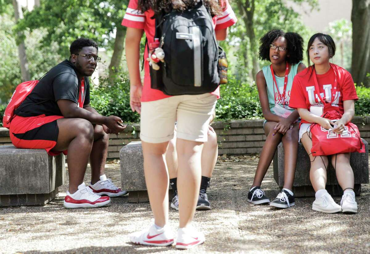 University of Houston incoming students listen to their guide while touring the campus as part of an orientation on campus on Tuesday, June 13, 2017, in Houston.