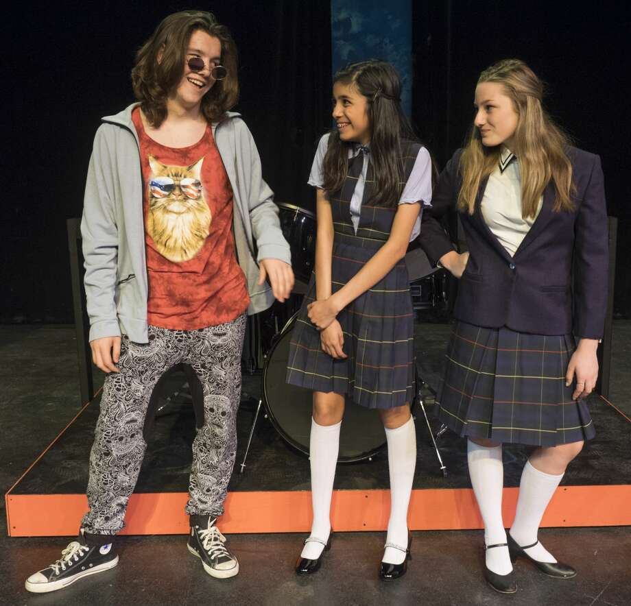 Dewey, Jonah Thacher, surpirses Christine, Meleah Heredia, middle, when he asks her to join the band with Summer, Hailey Arnold in Midland Community Theater's production of School of Rock. 6/29/17  Tim Fischer/Reporter-Telegram Photo: Tim Fischer/Midland Reporter-Telegram