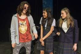 Dewey, Jonah Thacher, surpirses Christine, Meleah Heredia, middle, when he asks her to join the band with Summer, Hailey Arnold in Midland Community Theater's production of School of Rock. 6/29/17  Tim Fischer/Reporter-Telegram