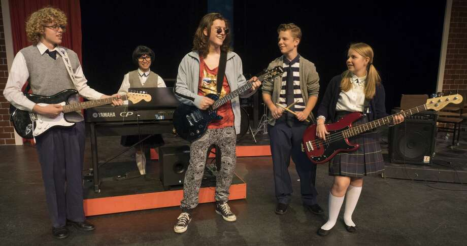 Jonah Thacher as Dewey, center, gives his band members,  Freddy, Ryan Smith, Laurie, Sarah Friday, Zack, Chris Cheek, and Katie, Abby Cheek in Midland Community Theater's production of School of Rock. 6/29/17  Tim Fischer/Reporter-Telegram Photo: Tim Fischer/Midland Reporter-Telegram