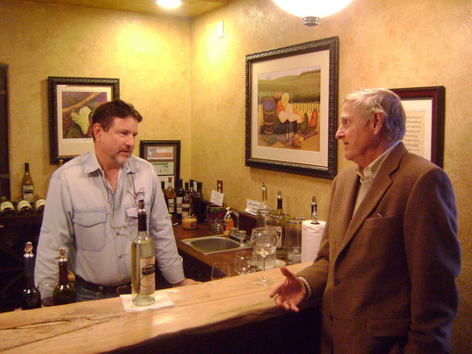Wine author, George Taber, right, visits with Jerry Bernhardt in the tasting room of the Bernhardt Winery near Plantersville. Photo: Courtesy Photo / Internal