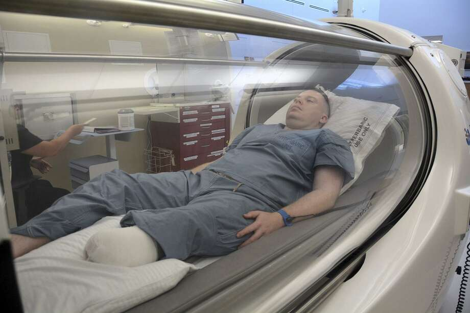 Army Capt. Kyle Salik is the first patient to receive oxygen therapy June 20 at the new Undersea & Hyperbaric Medicine Clinic at Brooke Army Medical Center at Joint Base San Antonio-Fort Sam Houston. Hyperbaric oxygen can be used to treat 14 different indicators including wound healing. Photo: Robert Shields