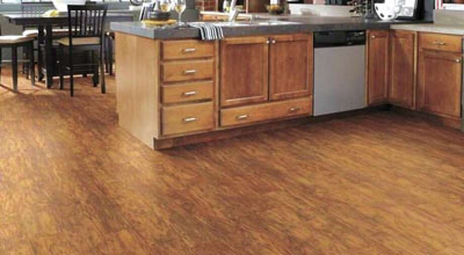 Get the deep, rich aura of wood in the kitchen? Looks like it! With  Floorté vinyl plank flooring from Shaw—available at Southwest Floors,  1113 Andrews Highway in Midland. Photo: Courtesy Photo