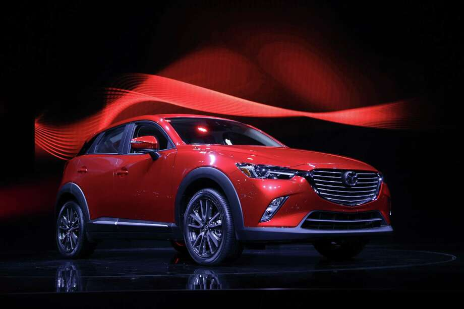 The 2016 Mazda CX-3 is unveiled at the Los Angeles Auto Show in Los Angeles. Mazda is recalling nearly 228,000 cars in the U.S. because the parking brake may not fully release or could fail to hold the cars, increasing the risk of a crash. The recall covers certain Mazda 6 cars from the 2014 and 2015 model years and the Mazda 3 from 2014 through 2016. Photo: Associated Press File Photo / Copyright 2017 The Associated Press. All rights reserved.