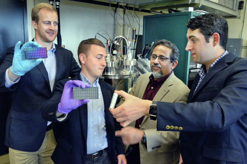 SUNY Poly/UAlbany students Graeme Housser, left, and Shane McMahon pose with their LUX solar panels, with professor and advisor Pradeep Haldar and fellow student Don DeRosa, right, and his EONIX ultra capacitor as they discuss launching new startups Wednesday June 28, 2017 in Albany, NY. (John Carl D'Annibale / Times Union)