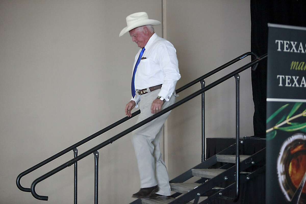 Agriculture Commissioner, Sid Miller, 61, was the guest speaker at the Texas Olive conference at Freeman Coliseum on June 16, San Antonio. Miller walks off the stage after his speech.