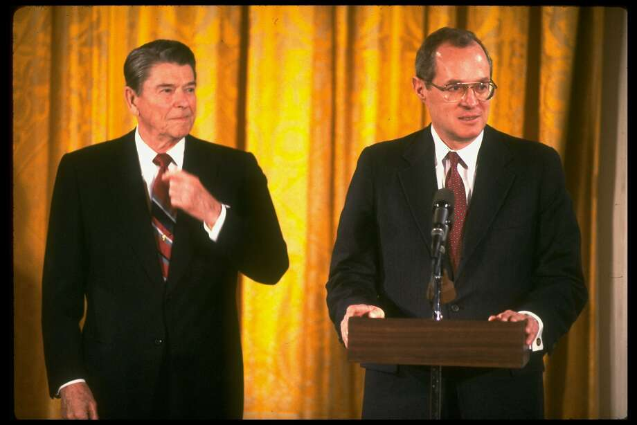 U.S. Supreme Court Justice Anthony Kennedy (right), with President Ronald Reagan at his side, speaks during his swearing-in ceremony in 1988. Photo: Dirck Halstead, The LIFE Images Collection/Getty Images