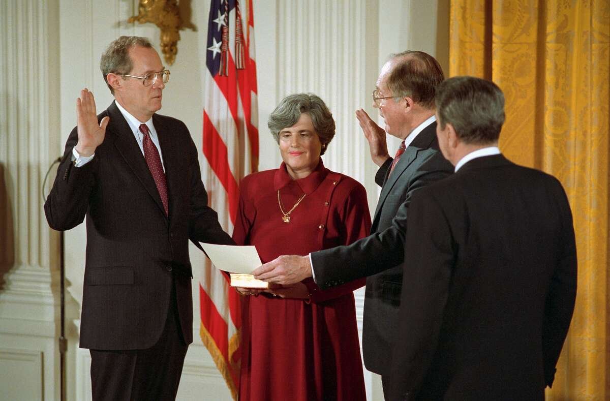 Anthony Kennedy (left), with wife Mary and President Ronald Reagan (right) looking on, takes the oath from Chief Justice William Rehnquist to serve on the U.S. Supreme Court in 1988.