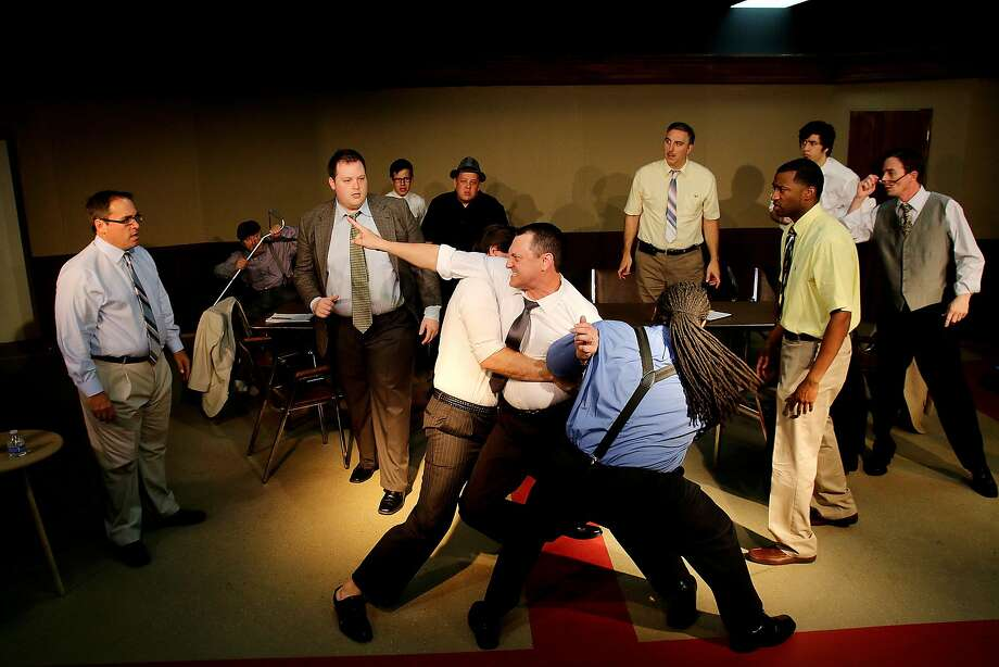 """VinceTortorice (far left) and Jeff Merriman (guy held) and Pearl Theatre players rehearsing a scene from """"12 Angry Men."""" Photo: Pin Lim, For The Chronicle"""