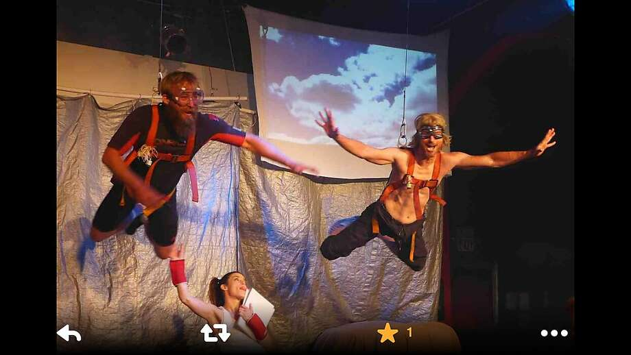 """The movie """"Point Break"""" features a famous skydiving scene, therefore the stage show """"Point Break Live!"""" must feature a skydiving scene. Charlie Farrell (right) plays Bodhi, the bank-robbing surfer played by Patrick Swayze in the movie. Photo: Courtesy Of """"Point Break Live!"""""""